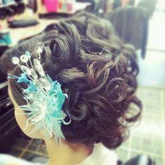 Quinceanera hair with a gorgeous hair clip!