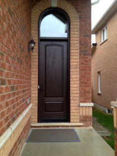 2 Panel Cambered Top Cherry Grain Fiberglass Door in dark walnut stain.