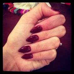 "Dark red stiletto nails ----> similar to what I have right now with ""Sugar Plum"" by SensatioNail"