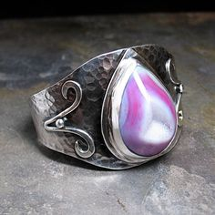 Sterling Silver Wide Cuff with Pink Agate Drusy made for a custom client.  The stone is enormous, and so much fun.  I will definitely be making another drusy cuff, as I bought extra stones.