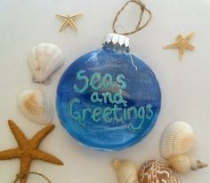 Items similar to Seas and Greetings Ornament - Beach theme Christmas Ornament- Hand painted glass ornament - Nautical Ornament - Coastal Christmas on Etsy Ocean Backgrounds, Wedding Gift Bags, Mermaid Art, Visual Effects, Beach Themes, Glass Ornaments, Christmas Bulbs, Original Art, My Etsy Shop
