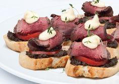 Beef Fillet with Tomatoes on Tapenade Encrusted Crostini- it tastes as good as it looks!