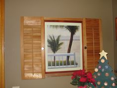 Old shutters made into frame around picture.