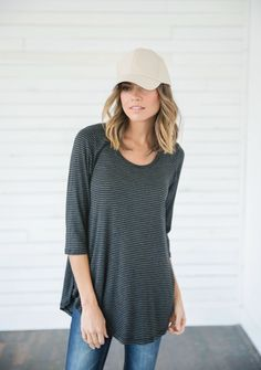 Our Seaport Charcoal Striped Top is the ultimate closet staple! We love the versatility of this simple charcoal and black striped shirt, because the possibilities are endless when you're rocking this top countless ways! || Bella Ella Boutique