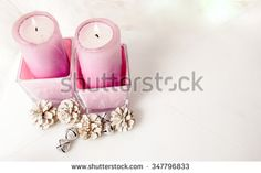 Candles with Christmas decorations on a white background. - stock photo