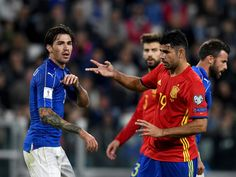 Alessio Romagnoli of Italy and Diego Costa of Spain are seen during the FIFA 2018 World Cup Qualifier between Italy and Spain at Juventus Stadium on October 6, 2016 in Turin, Italy.