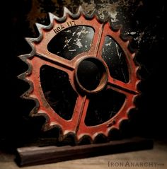 Stunning antique gear of thick cast iron in a dynamic industrial design! Raised…
