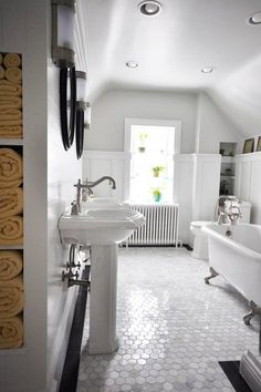 The third-floor gut and redo of this reader's bathroom with its board-and-batten paneling, hex marble tile and clever towel storage make it a standout in our annual Reader Remodel Contest.