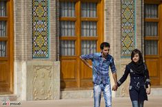 Tehran Couple - Dating scene is full time ON in Tehran and other cities. You go to any park or restaurant and you will find young couples roaming around hands in hands. This one was taken at historic Golestan Palace in Tehran.Canon 70-200mm f2.8 at ISO 100P.S: Shooting people discretely, knowing what you are doing is not right and feeling a bit embarrassed as a result doesn't give you much chance to be creative or capture the right moment. Apologies for the awkward moment captured but…