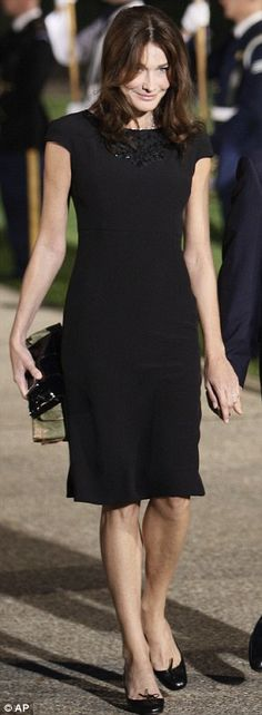 Timeless: Mrs Sarkozy dons a classic black dress to the G20 Summit dinner yesterday and Jackie O in Ireland in an undated picture (right)