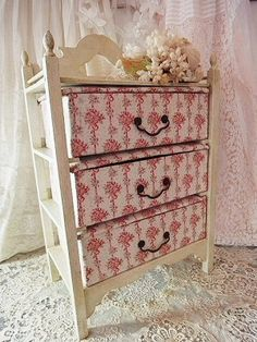 upcycle a small dresser w/no drawers - paint, buy or make box shapes (wood, plastic, cardboard) and cover how you choose