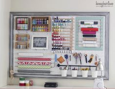 Is your craft closet unmanageable and overflowing? Frame a pegboard with some crown molding and add hooks to store craft supplies simply and elegantly. Get the tutorial at Honey Bear Lane.