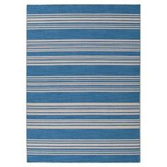 Flat-woven 100% wool rug with a Bermuda blue and tan striped motif.    Product: RugConstruction Material: 100% WoolColor: BlueFeatures:  ReversibleDurableEasy care Note: Please be aware that actual colors may vary from those shown on your screen. Accent rugs may also not show the entire pattern that the corresponding area rugs have.Cleaning and Care: Vacuum regularly. Blot spills immediatley with cold water. Avoid direct sunlight to prevent fading. Periodic professional cleaning is…