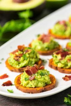 Baked Sweet Potato Bites topped with avocado, bacon, and cilantro. This easy, crowd-pleasing appetizer is always a hit at parties! Gluten free and Paleo.