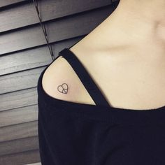 Peace symbol heart tattoo on the right shoulder.Done by Hongdam