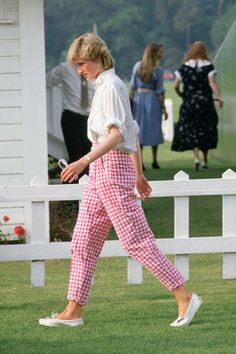 June 20, 1986: Princess Diana wearing pink gingham trousers and white shirt at Guards Polo Club, Windsor. There is another photo with William as a young child. Princess Diana also wore this outfit in 1981. Date update from Getty images.