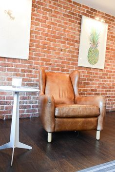 MADE Customer Leo's Rubens Armchair matches his exposed brick wall perfectly. MADE.COM/Unboxed