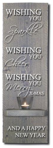 """Decoratiemeubel (19,5 x 60 cm) van greywash steigerhout met de tekst """"Wishing you sparkle, wishing you cheer, wishing you merry X-mas and a happy new year"""". Leuk om op te hangen in de keuken, de hal of in een andere kamer. Het bord is voorzien van één schap met een glazen theelichthouder en een waxine-lichtje. Het meubel wordt als eenvoudige bouwpakket geleverd, inclusief bevestigingsmateriaal."""