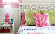 This Is A Bright & Stylish Bedroom!! The Pink and Green Pillows Add A Pop Of Color To An All White Palette.