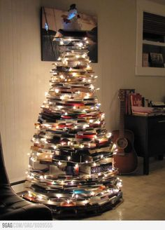 A bookworm's Christmas tree.  This would be cool to do, unless the books were your favorite and unable to part with them.  Which as a book lover, may be me :)