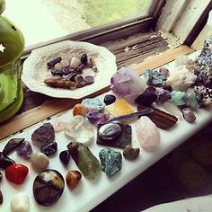 Crystals and quartz receiving energy on a window sill.