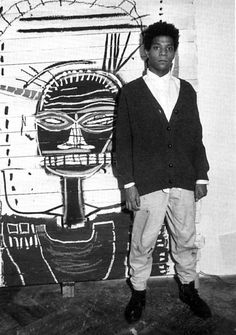 Jean-Michel Basquiat Just saw another post here, that celebrated his death... I prefer to remember him like this: prime of life, flanked by stellar artwork !!!