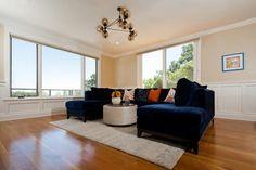 Open Contemporary Living Room With Dark Navy Sofa