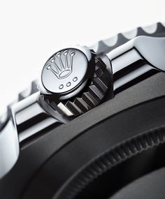 The Rolex Submariner's screw-down Triplock winding crown –  inspired by the hermetically sealed hatch of a submarine –is designed for maximum waterproofness, security and ease of handling. It is protected by a crown guard stamped as an intergral part of the middle case.