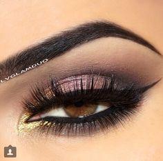 Gold browns eye makeup.