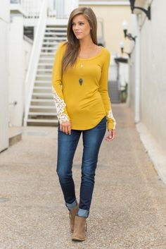 We. Are. So. Obsessed. With. This. Top! The fit is insanely flattering and that shade of mustard yellow could not be more flawless! The sleeves bear some seriously gorgeous crochet, too.