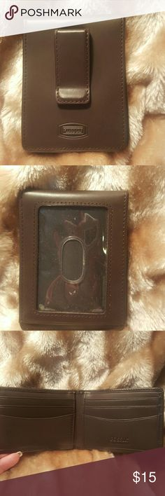 Fossil Card / I.D. Holder NWOT- This has never been carried.  GENUINE LEATHER  Has 6 Card Slots on the inside & 1 on the outside for your I.D., Also a clip for ur money or to clip on the inside of your purse. From a pet and smoke-free home.  If you have any questions please comment below as I usually respond within 24hrs or less.  Thanks for looking & Happy Poshing!!!🌺 Also, Feel free to stop by my closet as items are added weekly. Fossil Accessories