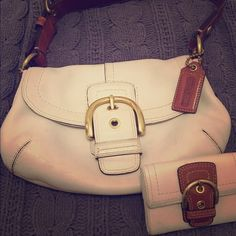Coach leather purse and wallet Pre loved Coach cream with brown strap purse with matching wallet. Purse definitely has some wear but is in good shape. Wallet is in great shape. Coach Bags Shoulder Bags