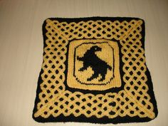 Hufflepuff Pillow cover by gargoylelib, via Flickr