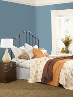 Pair blue walls with earthy browns, tans, and leafy patterns to create a nature-inspired bedroom reminiscent of a sunny autumn day. Hidden Harbor Blue 70BG 32/238 by Glidden