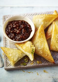 Use filo pastry to make lighter baked samosa stuffed with potatoes and peas.