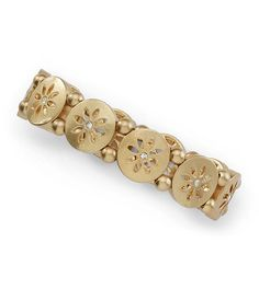 DAISY CHAIN -- Daisies play end-to-end in this cut-crystal accented stretch bracelet. -- Spring/Summer 2013