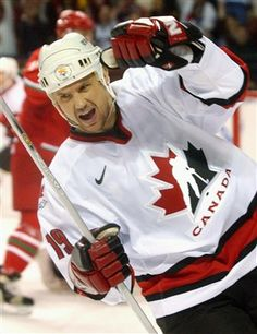 """""""Canada's Steve Yzerman reacts after scoring a first period goal in their semifinal match with Belarus on Feb. 22, 2002 at the 2002 Salt Lake Winter Olympics in Kearns, Utah."""""""