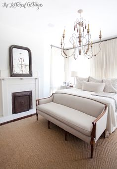 Master Bedroom | White and Neutrals | Fireplace | Chandelier | Loveseat at foot of bed