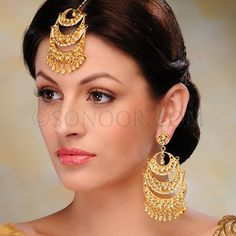 ACR/1/3312 Tika and Earrings  in dull gold finish studded with kundan and pearls	 $248 £146