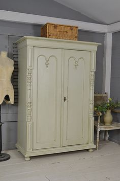 #letstrove In it's original green paint, this rustic Dutch beauty will add a charming addition to any bedroom! We love it's column detail and ample hanging space.  With FREE UK DELIVERY! https://www.thetreasuretrove.co.uk/bedroom-storage/2-door-shabby-chic-rustic-wardrobe #rustic #dutchfurniture #shabbychic #vintagefinds #green