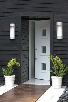 August is outdoor lighting month so Check out these inspiration galleries to get the creative juices flowing. Now is the time to replace your outdoor lighting before winter. Nothing raises your curb appeal faster! Modern Entrance, Modern Door, Modern Exterior, Exterior Colors, Exterior Paint, Exterior Design, Interior And Exterior, Modern Entryway, Grey Exterior