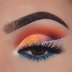 Blue lower lashline. Red cut crease and glitter wing.