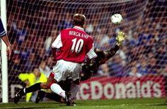 Arsenal's Dennis Bergkamp scoring a goal.