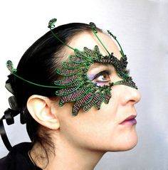 Hey, I found this really awesome Etsy listing at http://www.etsy.com/listing/169451476/green-and-purple-bird-masquerade-mask