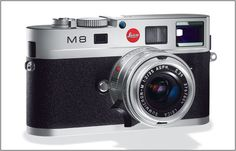 Leica M8 rangefinder camera. Hand-built, old world quality, manual focus; digital internals c/w RAW image format support. With Leica16-18-21 mm F4 aspherical lens, $6000.