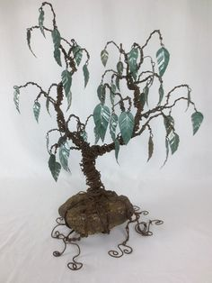 Twisted Barbed Wire Tree With Metal Leaves  by thedustyraven