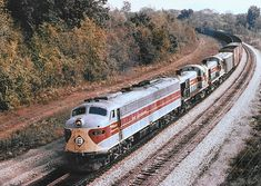 Erie Lackawanna EMD E8A diesel electric locomotive # 832, is seen leading two Alco RS3's, while hauling a mixed merchandise freight train at Huntington, Indiana, 10-03-1973