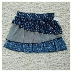 """NWT Maurice's Tiered Asymmetrical Mini Flirty and feminine with a comfortable 2.5"""" smocked waist. Fabric has serged edges and is completely lined. Measuring inside liner laying flat: Waist 17"""" Hips 25"""" Length 18"""" Maurice's Skirts Mini"""