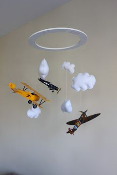 DIY mobile with felt clouds and model airplanes.