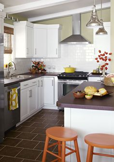 Dark tile works well in this kitchen with white cabinets.